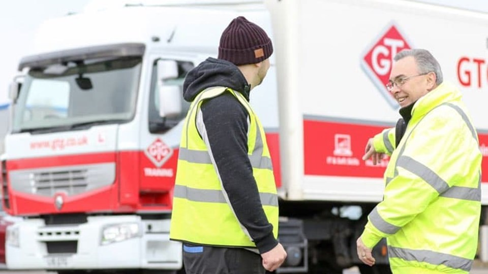 two men in front of GTG training lorry