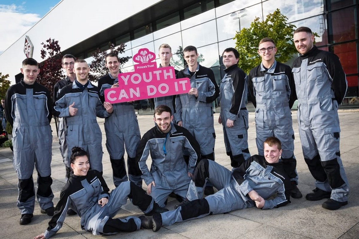12 GTG Princes Trust apprentices holding a pink 'Youth Can Do It' sign